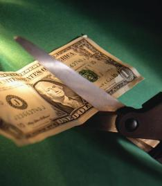 Cutting a One Dollar Bill with a Scissors
